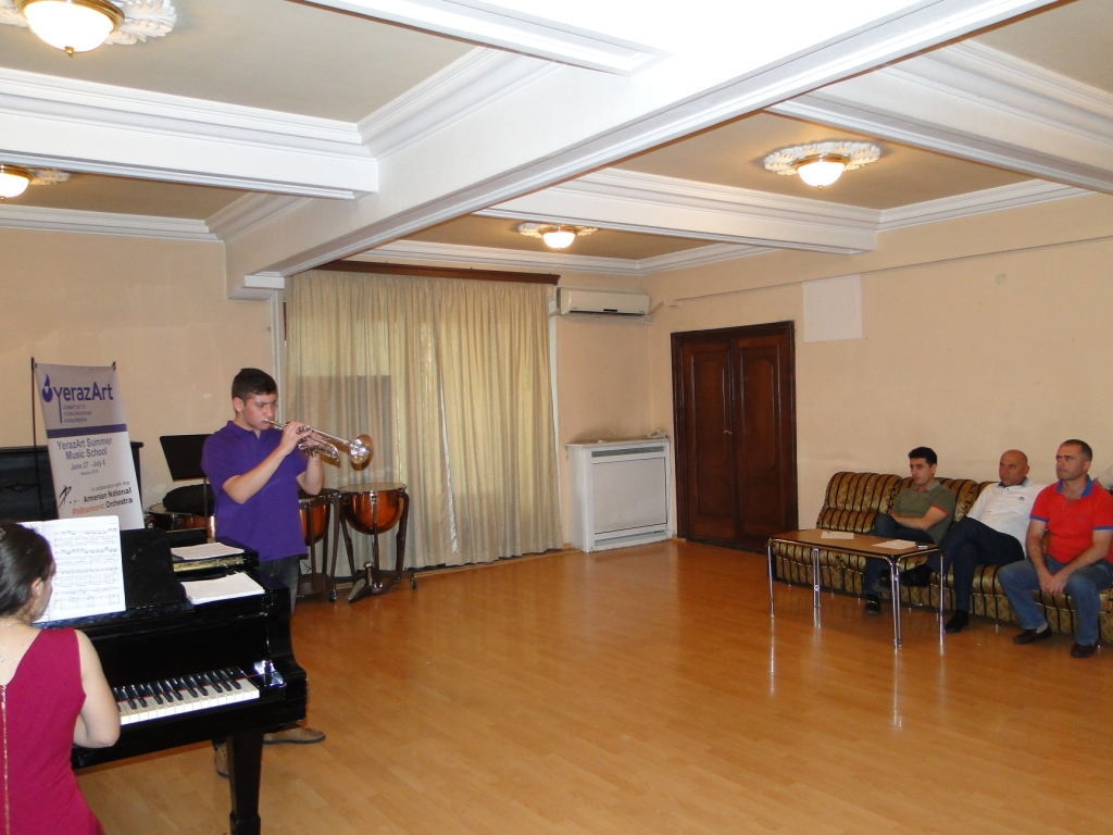 Daniel_Melkonyan_with_Maestro_Eduard_Topchjan_and_teachers.JPG